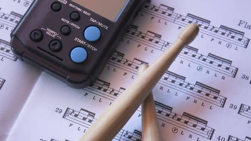 Metronome, drumsticks and notes