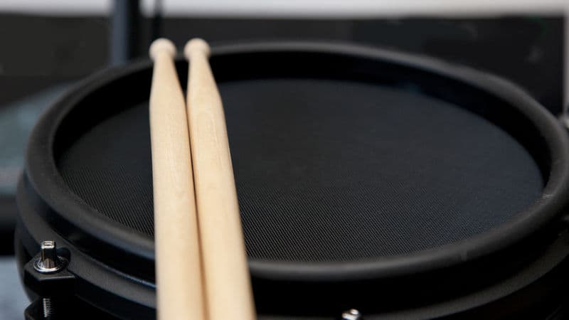 Rubber trigger pad and drum sticks